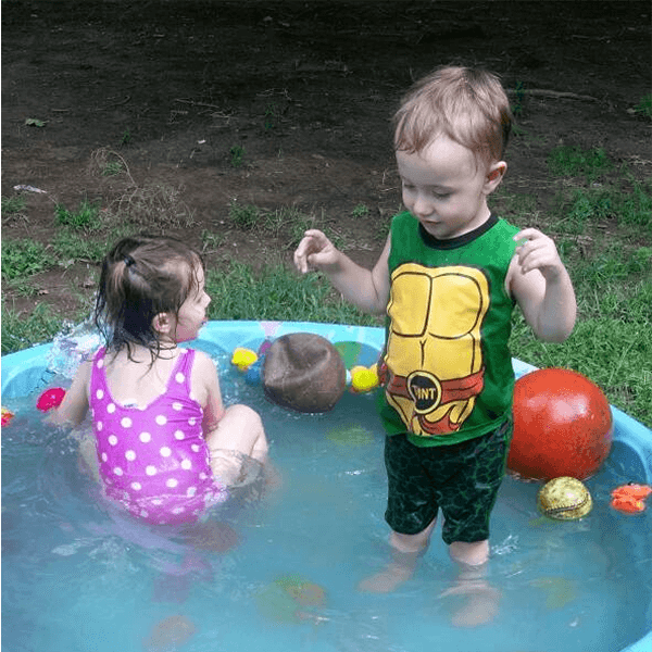 foster children playing in pool