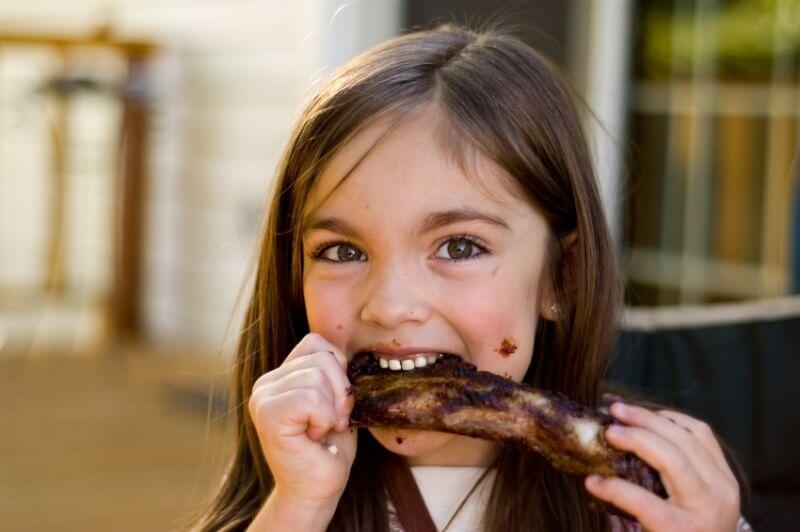 kid eating rib