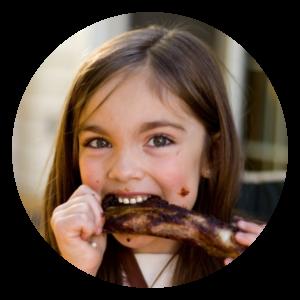 girl eating ribs